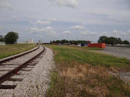 "MWRX 2944 sits off in the distance in the ""Triangle"" at the Leipsic Rail Park - Transload Site # 3."
